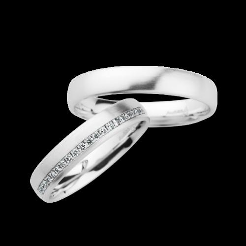 Witgouden trouwringen met diamant van Christian Bauer